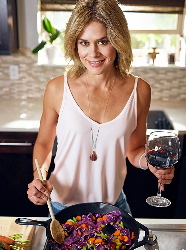 Katie Garces cooking with wine